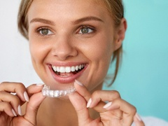 woman smiling Invisalign