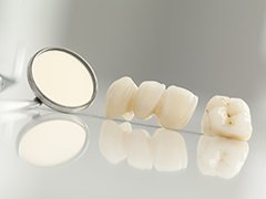 Dental crown and bridge restorations prior to placement
