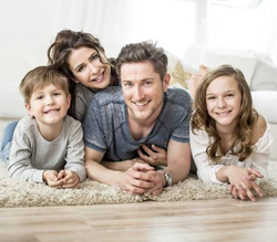Family smiling on carpet