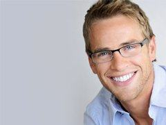 young man smiling with dental implants in Torrance