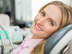 Smiling woman in dental exam chair