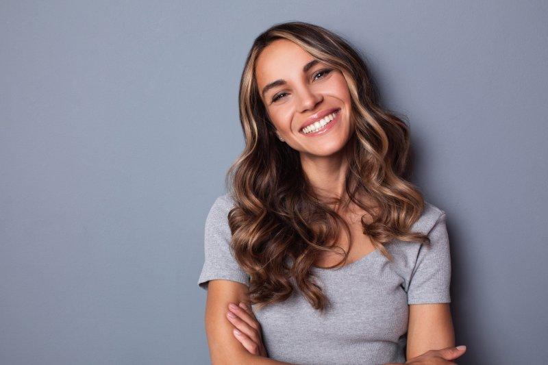 Woman smiling with porcelain veneers