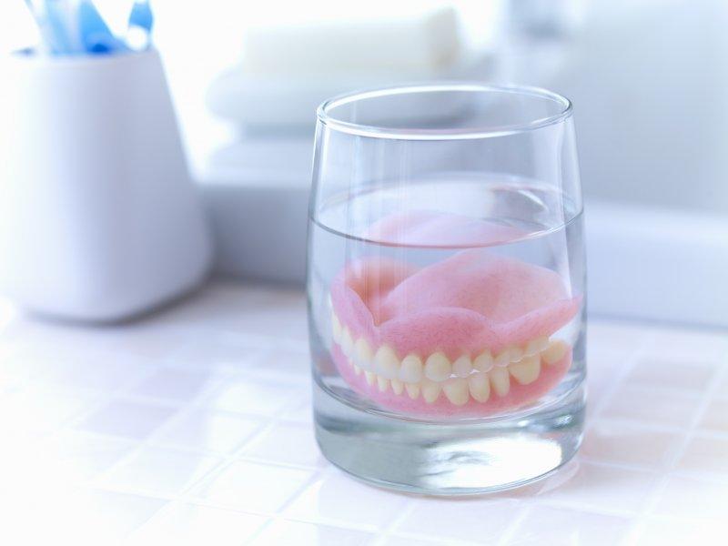 Dentures soaking in glass