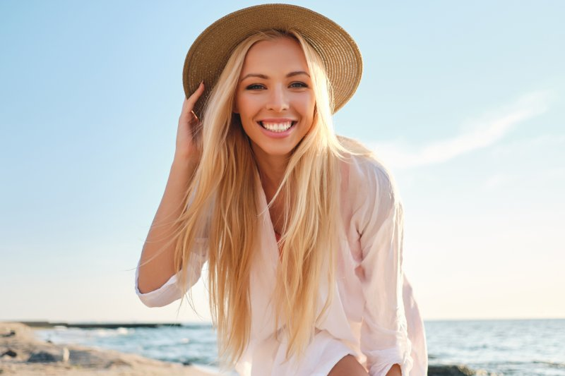 Woman on a beach with brilliant smile