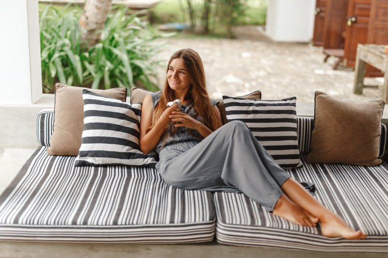 Smiling woman relaxing on patio in the summer